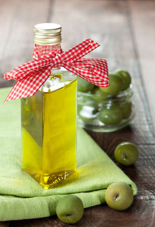 cooking oil: fresh olive oil in a bottle with olives
