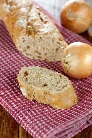 dishtowel: fresh onion bread on dishtowel  Stock Photo