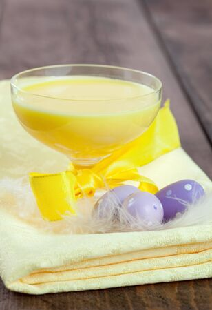 eggnog in a glass and easter eggs  photo