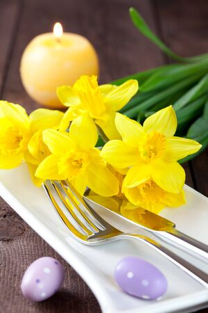 place setting for easter with daffodils