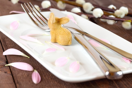 easter place setting with petals and willow  photo