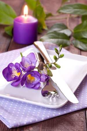 freesia: place setting with freesia and candle Stock Photo