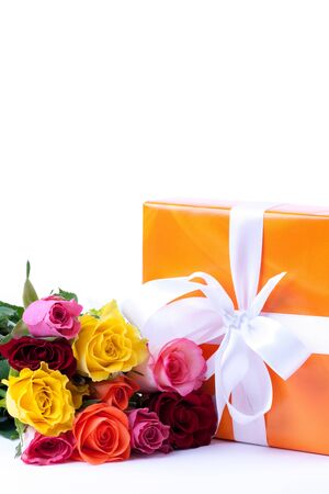 present and bunch of roses isolated on white background  Stock Photo - 8951551