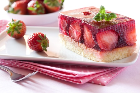 fresh strawberry cake with mint leaf on plate