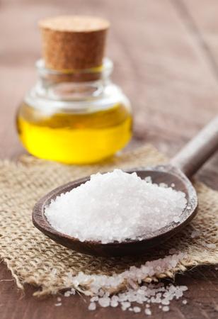 salt crystal: sea salt and oil on a table