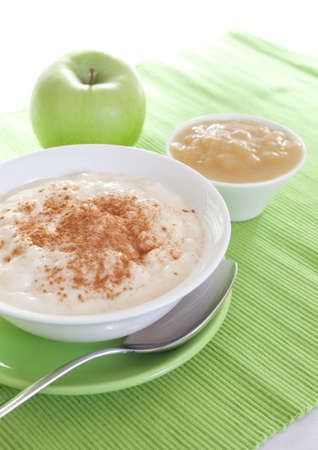 fresh rice pudding in bowl with applesauce  photo