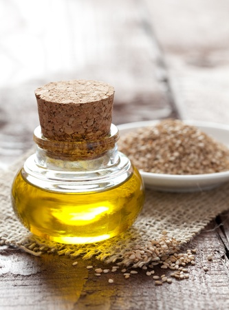 sesame: sesame oil and sesame seeds on table  Stock Photo