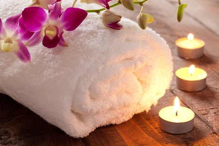 spa bath: spa concept with candle and towel  Stock Photo