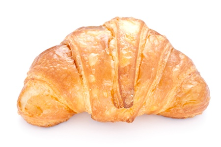 fresh baked croissant isolated on white background  photo