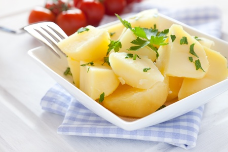 jacket potato: fresh boiled potatoes with parsley in bowl