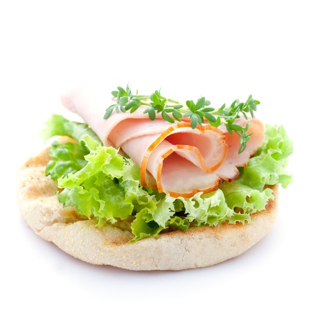 bap: english muffin with ham isolated on white background