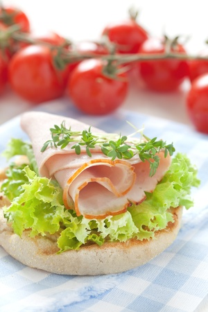english muffin with ham and salad photo