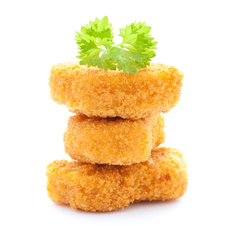 breaded: raw chicken nuggets stacked isolated on white background