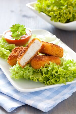 chicken nuggets: fresh chicken nuggets with ketchup and salad  Stock Photo