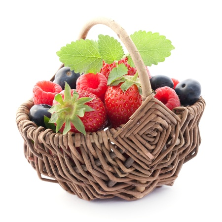 fruits in a basket isolated on white  Stock Photo - 9616382