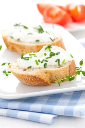 fresh herb cheese on baguette  photo