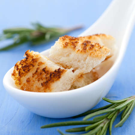 croutons: fresh croutons on spoon  Stock Photo