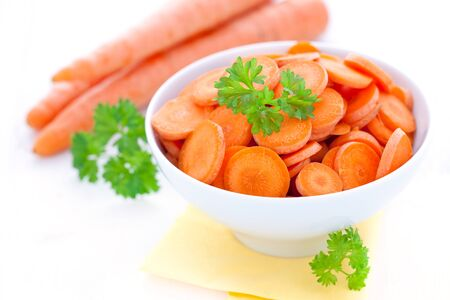 sliced carrots in bowl with parsley  photo