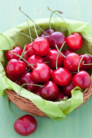 sweet and sour: fresh cherries in a basket  Stock Photo