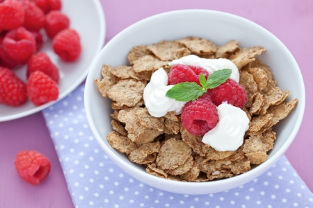 fresh whole wheat flakes and raspberries in bowl Stock Photo - 9980555