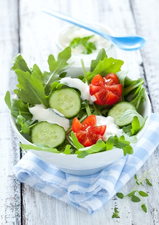 arugula: fresh salad with cucumber and tomato