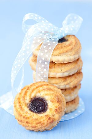 fresh cookies with jam and a ribbon photo