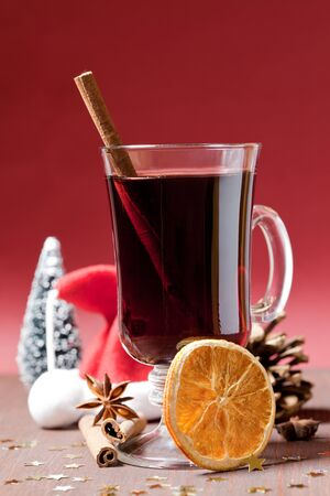 grog: fresh mulled wine in a glass with cinnamon