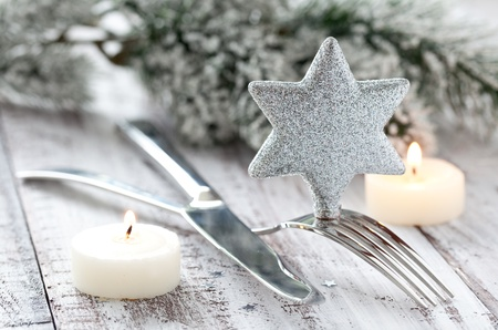 christmas dish: silver table setting with candles