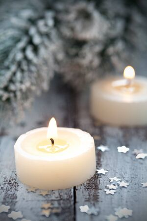 candle light: two christmas candles with decoration  Stock Photo