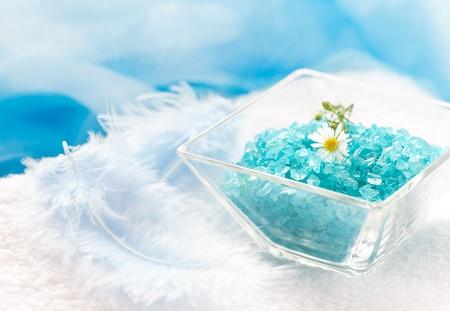 blue bath salt in bowl with blossom  photo