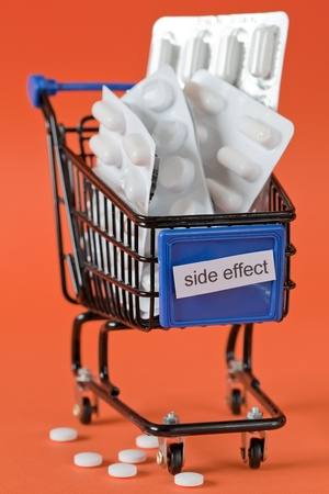 side effect: shopping cart with pills and label side effect   Stock Photo
