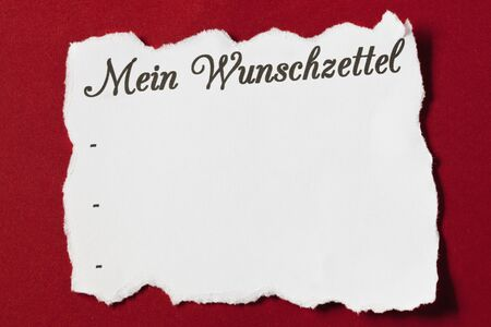 wish list on red background with copy space german photo