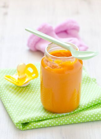 fresh baby food in a glass with spoon  photo