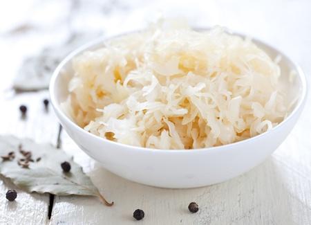 fresh pickled cabbage (german sauerkraut) with ingredients in bowl