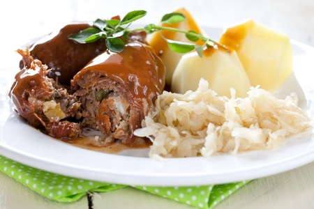fresh beef roulades with potatoes and sauerkraut