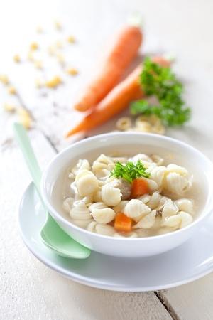 noodle soup: fresh noodle soup with carrots in bowl  Stock Photo