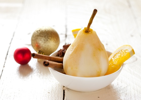 fresh poached pear in orange juice  Stock Photo - 10512183