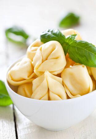 fresh raw tortellini with basil Stock Photo - 10512187