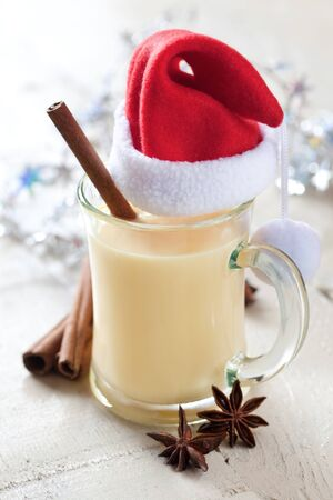 eggnog for christmas with cinnamon stick photo