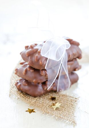 fresh gingerbread cookies with almonds and ribbon photo