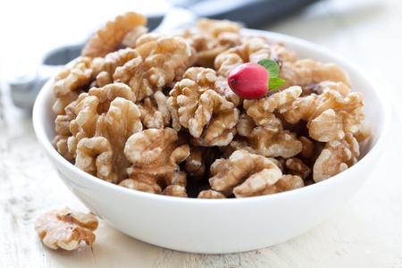 walnuts in bowl with nutcracker  photo
