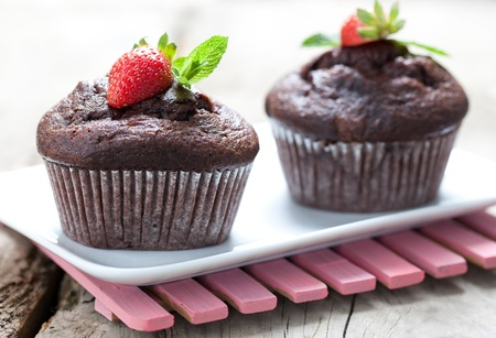 fresh chocolate muffins with mint on a plate Stock Photo - 10966654