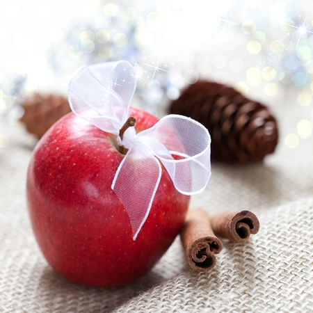 apple with ribbon and cinnamon sticks  photo