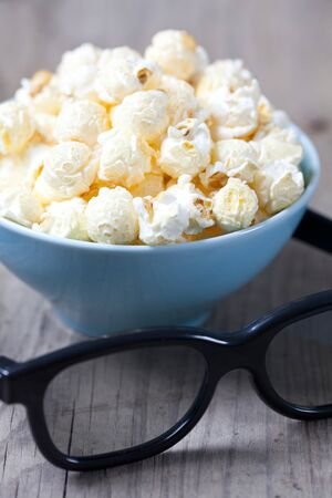 fresh popcorn in a bowl and 3D glasses Stock Photo - 10966644