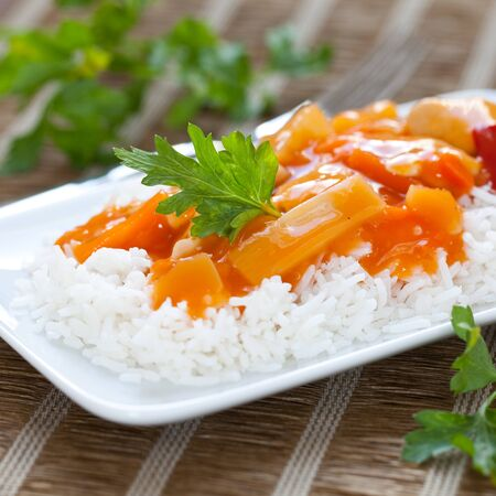 chinese rice meal with sweet sour chicken photo