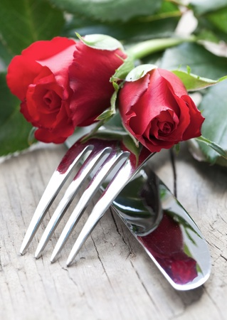 small table setting with red roses  Stock Photo
