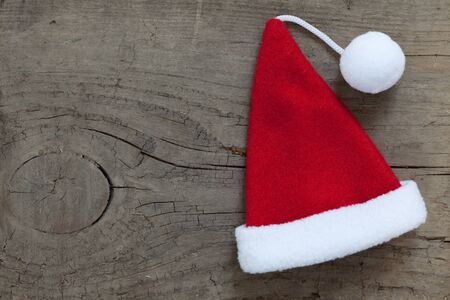24 month old: santa hat on wooden background with copy space