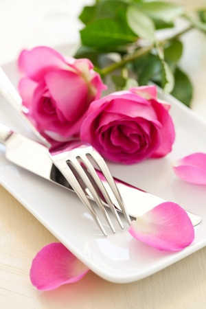 valentin: table setting with cutlery and rose  Stock Photo