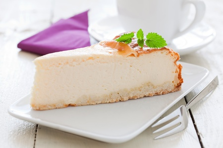 fresh cheesecake on a plate with mint  photo