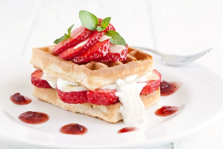 fresh dessert with waffle and strawberries  photo